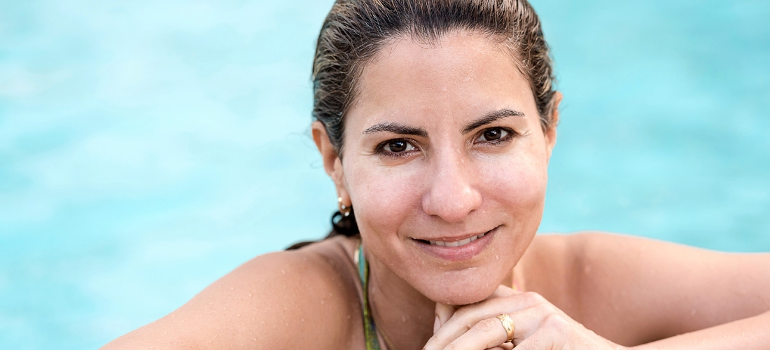 mature hispanic woman in the swimming pool